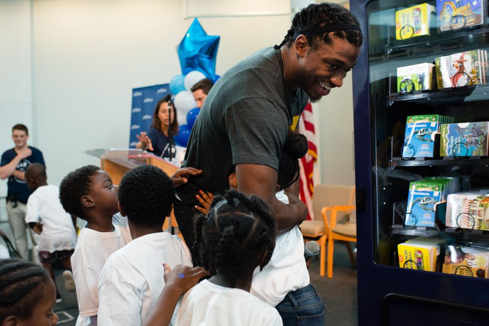 Redskins Robert Griffin III, center, gets hugs from the children at The Salvation Army in Anacostia. On Wednesday, July 8, 20