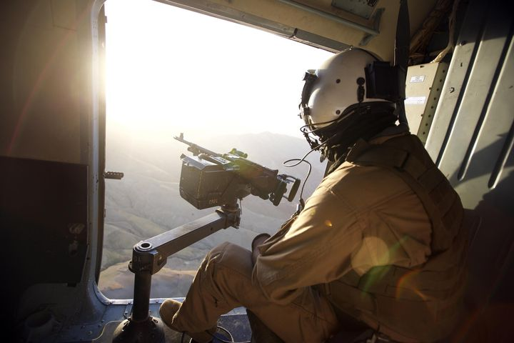 An Afghan soldier is seen in a helicopter during a military operation from Sar-e Pol, Afghanistan, on Aug. 29, 2015, as