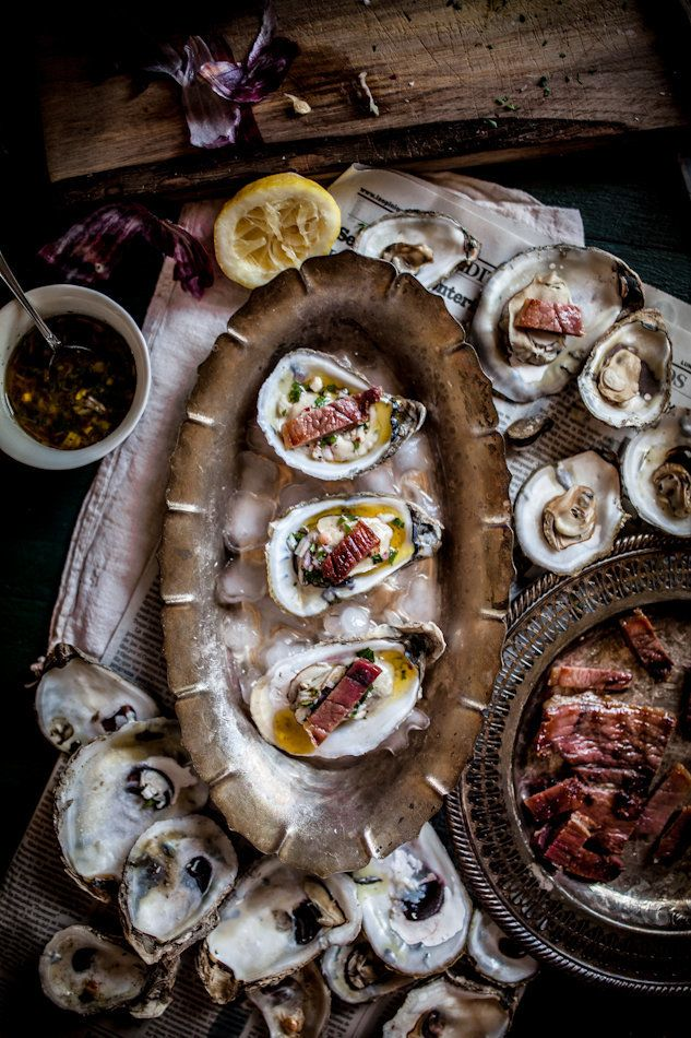 "<strong>Get the <a href=""http://www.adventures-in-cooking.com/2013/06/grilled-oysters-on-half-shell-with.html"" target=""_blank"