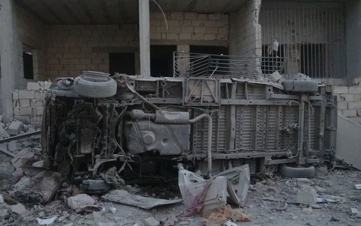 A burnt out ambulance is seen after the Sahra hospital was bombed by the Syrian Army in Idlib, Syria, on Aug. 10, 2015.