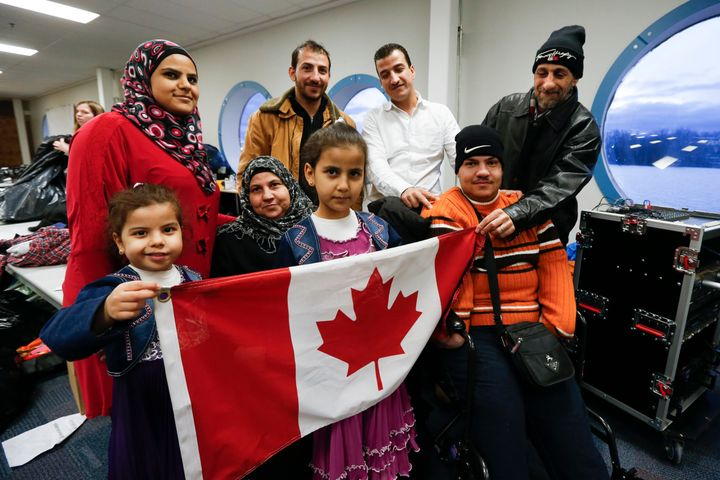 A Syrian family, sponsored by a local group called Ripple Refugee Project, attends a dinner for refugees at the Toronto