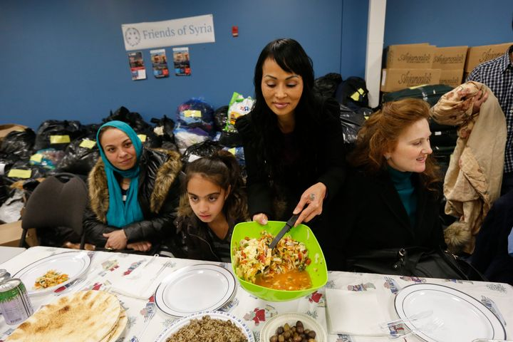 Tina Tran, a refugee who came to Canada from North Vietnam thirty years ago, helps Friends of Syria host a dinner for refugee