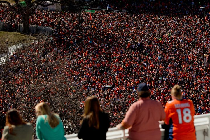 Fans of the Denver Broncos fill Civic Center Park as more watch from a balcony during a victory rally to celebrate their Supe