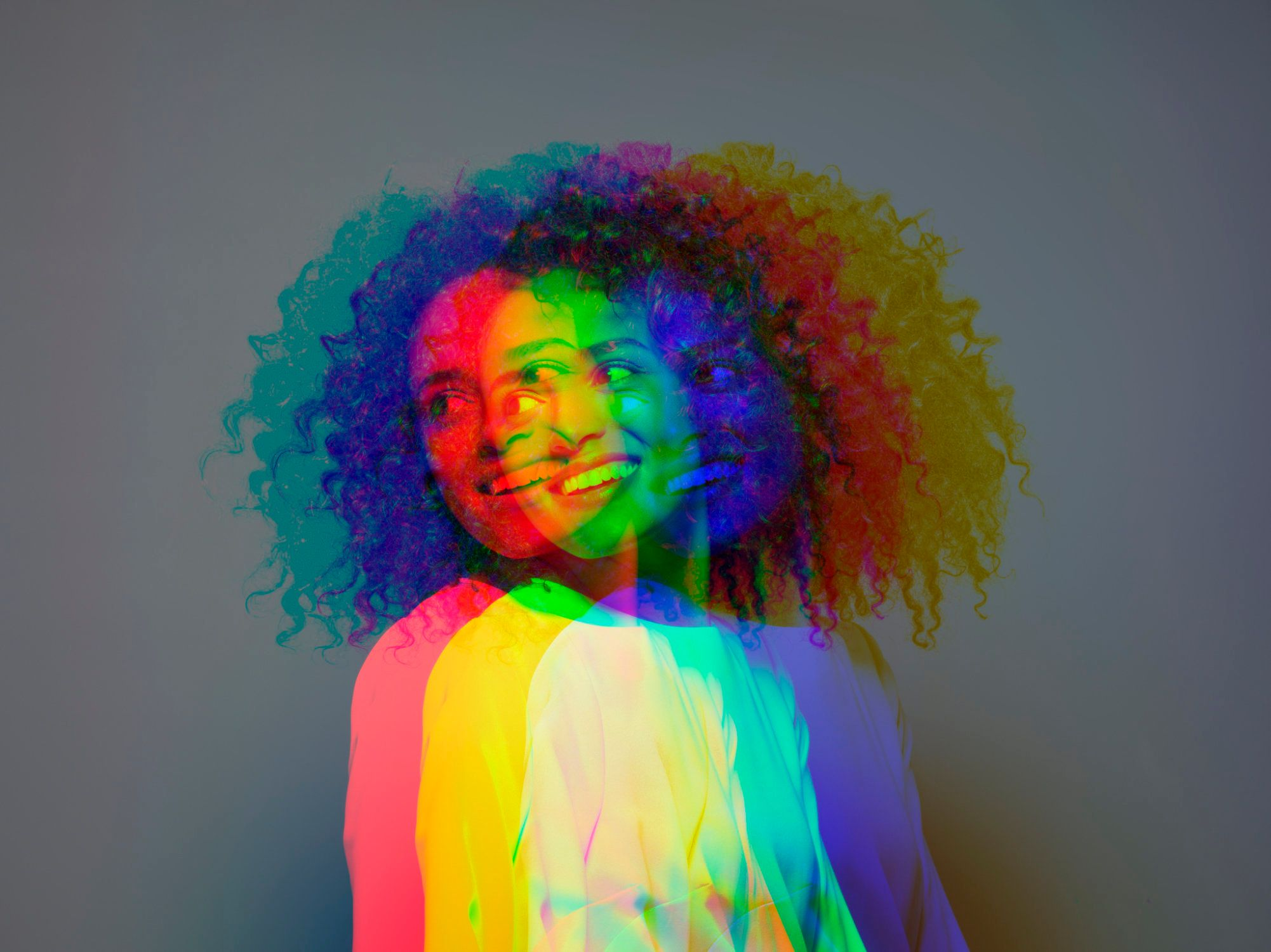 Multiple exposure,dark skinned female smiling