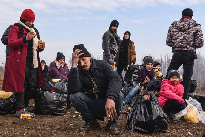 People rest after crossing the Macedonian border into Serbia in January. Migrants are trying to move north as fast