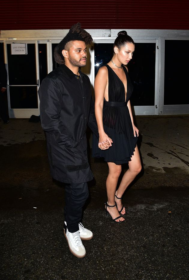 Weeknd and Bella Hadid leave the Alexander Wang fashion show at Pier 94 for on September 12, 2015 in...