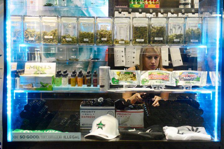 Budtender Kirsten Duncan refills plastic jars at Starbuds in Aurora, Colorado, in September, 2015.