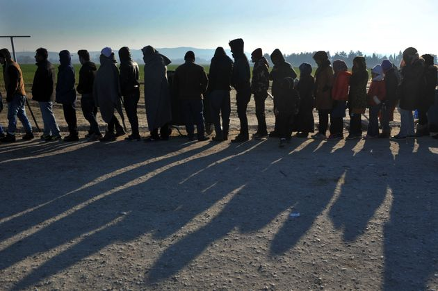 Peopleline up to receive food near Idomeni, Jan. 21, 2016. Some Greek locals have organized protests...