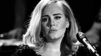 COLOGNE, GERMANY - DECEMBER 06:  (EDITORS NOTE: THIS IMAGE HAS BEEN CONVERTED TO BLACK AND WHITE) Adele performs live on stage during the television show 2015! Menschen, Bilder, Emotionen - RTL Jahresrueckblick on December 6, 2015 in Cologne, Germany.  (Photo by Sascha Steinbach/Getty Images)