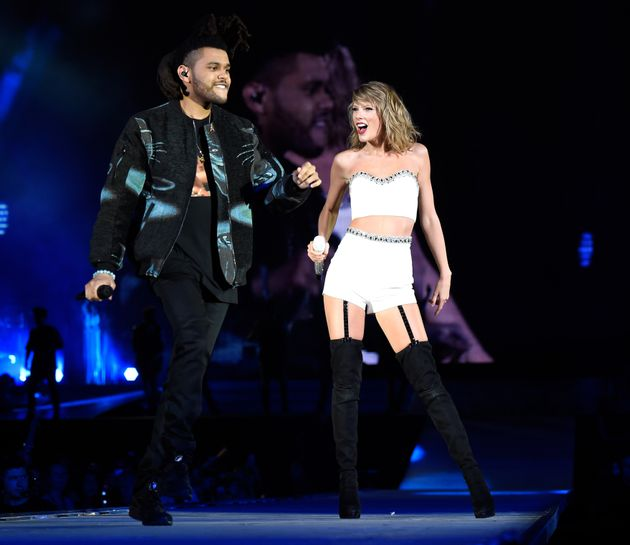 Singer/songwriter Taylor Swift performs onstage with The Weeknd during The 1989 World Tour Live at MetLife...