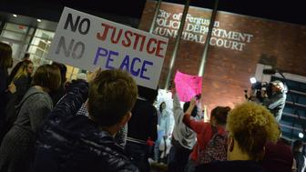 FERGUSON, MO -  MARCH 11: Protestors demonstrate outside the Ferguson Police Department on March11, 2015 in Ferguson, MO. Protests erupted after the announcement of  the resignation of Ferguson Police Chief Tom Jackson earlier in the day. (Photo by Michael B. Thomas/Getty Images)