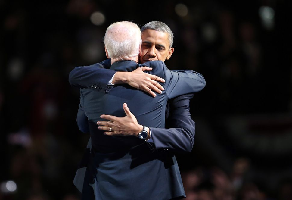 NOVEMBER 06: U.S. President Barack Obama and U.S. Vice President Joe Biden embrace on stage after his victory speech on elect