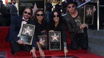 Members of the rock band 'Mana' (L-R) Alex Gonzalez, Sergio Vallin, Juan Calleros and Fher Olvera at the ceremony honoring them with the 2,573rd star on the Hollywood Walk of Fame in Hollywood, California on February 10, 2016. / AFP / Mark Ralston        (Photo credit should read MARK RALSTON/AFP/Getty Images)