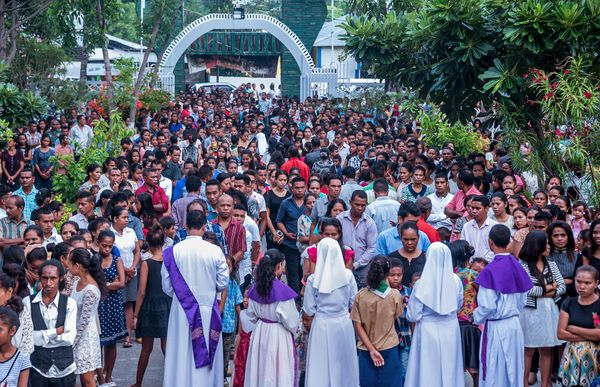 East Timorese Catholics queue up to attend a mass to celebrate Ash Wednesday in Dili.