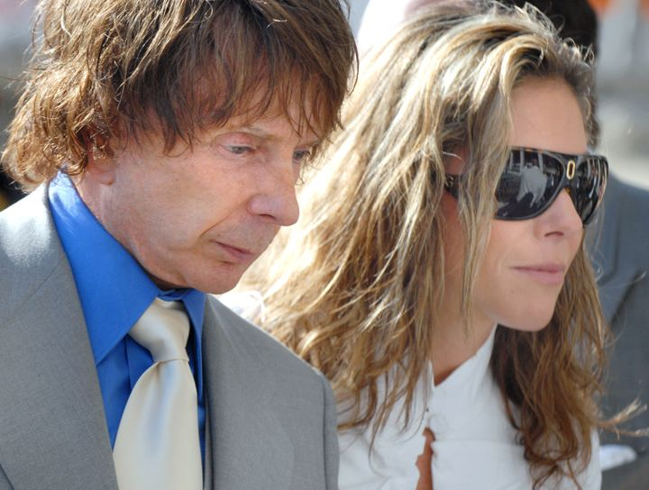 Phil Spector, left, and his wife Rachelle Short leave the Los Angeles Superior Court in Los Angeles, California, on Sept. 20,