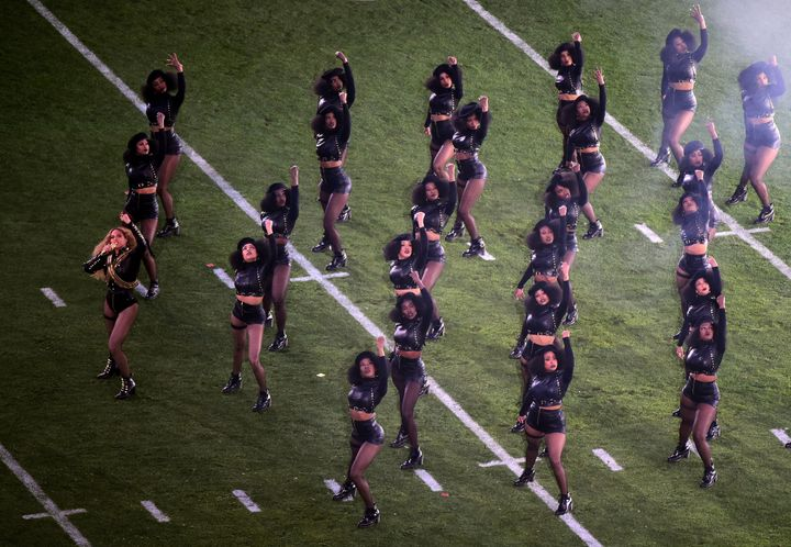 Beyonce and her dancers in Black Panther-inspired outfits dance during the Super Bowl 50 halftime show.
