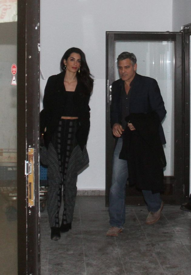 George and Amal Clooney at Grill Royal restaurant in Berlin 10.02.2016 56bca1ec1f00000d01217cd5