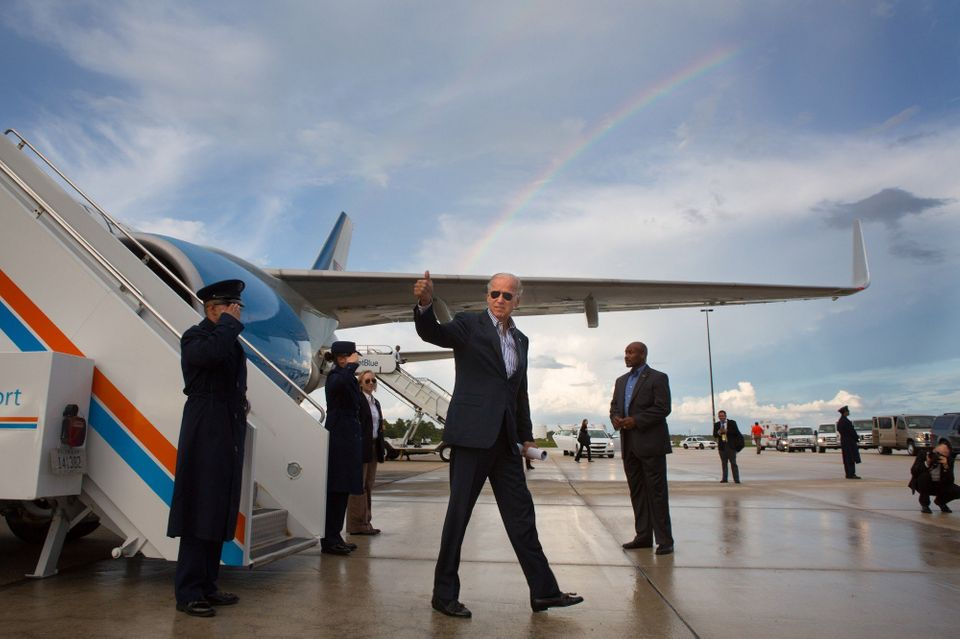 Biden gives a thumbs-up after landing at Southwest Florida International Airport on Sept. 28, 2012.