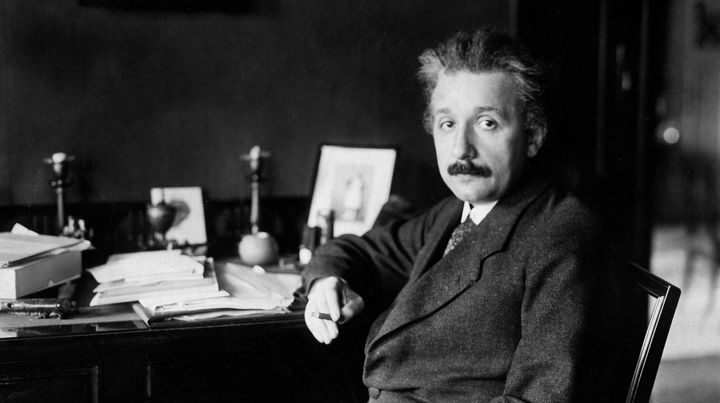 Albert Einstein at his desk in Germany in 1929. It was years prior, in 1916, when he predicted the existence of gra