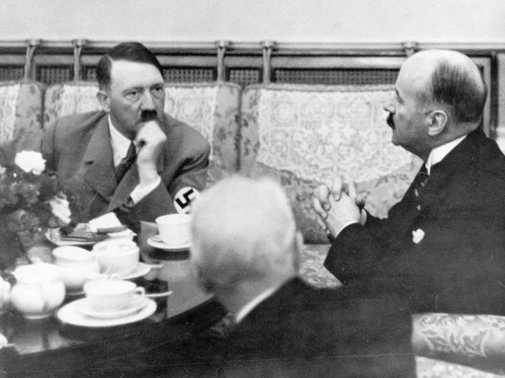 Hitler drinks tea at a hotel in Germany while meeting with the French Ambassador Andre Francois-Poncet in 1937.