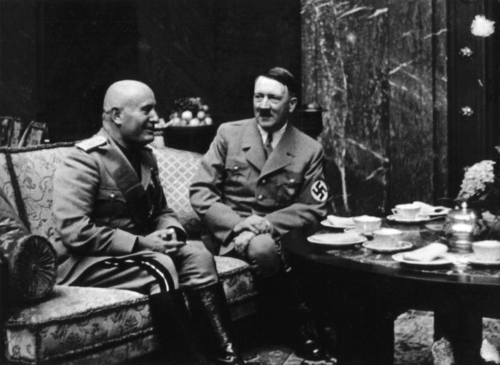 Hitler and Benito Mussolini drink tea in Munich in 1937.