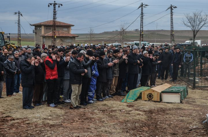 Mourners at a funeral for civilians killed in a Kurd-linked bomb attack targeting a police station in Diyarbakir.