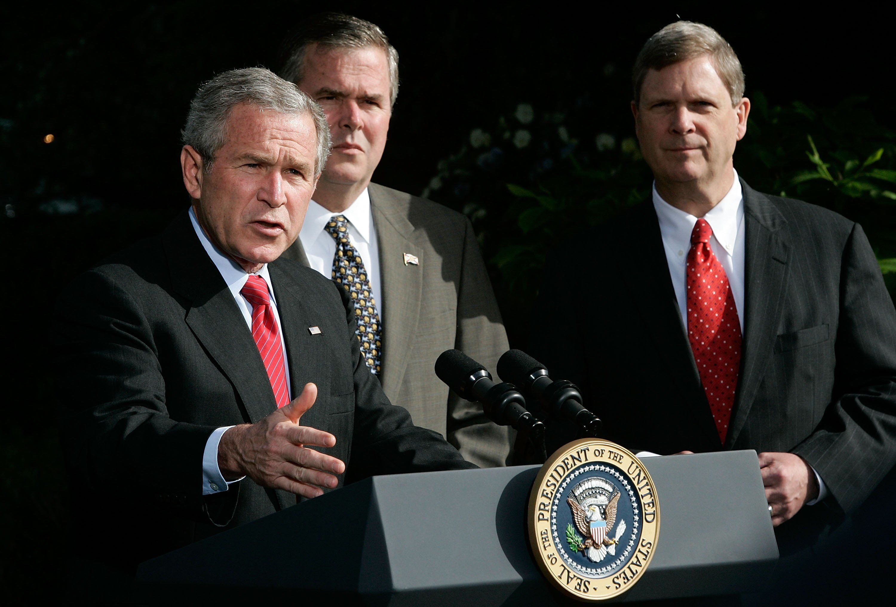WASHINGTON - APRIL 19:  U.S. President George W. Bush (L) speaks to the press on the war on terror as Iowa Democrtaic Governor Tom Vilsack (R) and Florida Republican Governor Jeb Bush look on after a meeting April 19, 2006 at the White House in Washington, DC. The governors have returned from a trip to Iraq and Afghanistan.  (Photo by Alex Wong/Getty Images)
