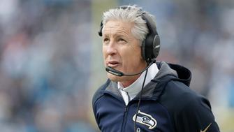 Seattle Seahawks head coach Pete Carroll watches play against the Carolina Panthers during the first half of an NFL divisional playoff football game, Sunday, Jan. 17, 2016, in Charlotte, N.C. (AP Photo/Bob Leverone)