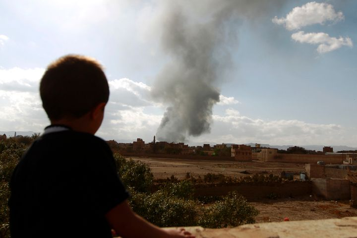 A Yemeni boy watches smoke rise following airstrikes in the capital Sanaa in January. The war in Yemen has seen a surge in ch