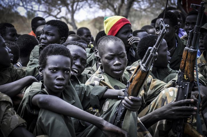 Young boys appear at a disarmament, demobilization and reintegration ceremony in South Sudan in 2015.