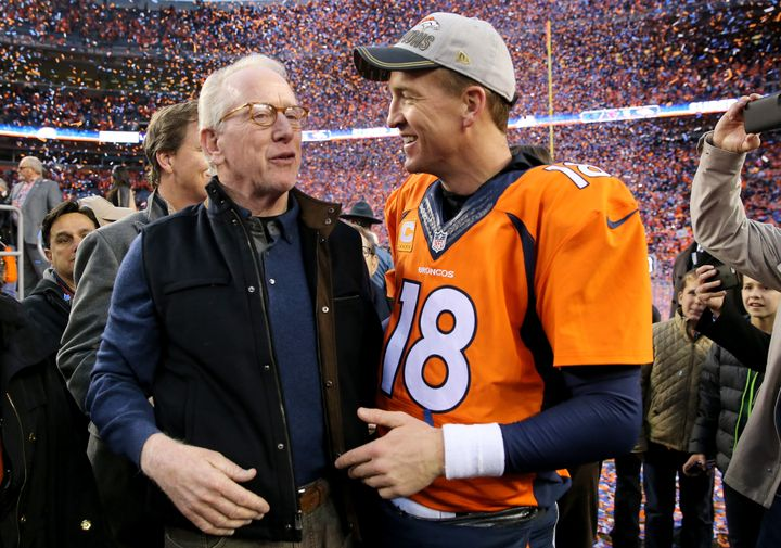 Peyton and father Archie Manning walk off the field after the Denver Broncos defeated the New England Patriots in the AFC Cha