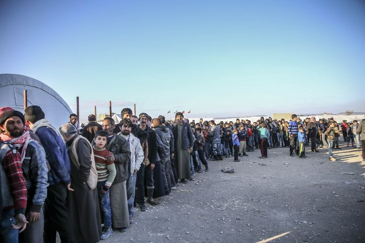 Over 50,000 peopleare stranded along the Syrian-Turkishborder as they flee pro-Syrian government attacks on Alepp