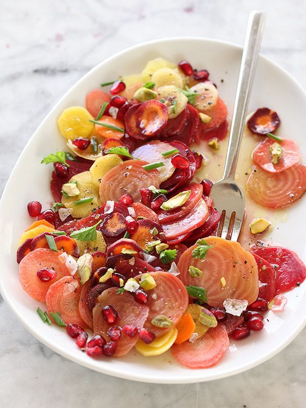 """<strong>Get the <a href=""""http://www.foodiecrush.com/2013/12/beet-carrot-and-pomegranate-salad/"""" target=""""_blank"""">Beet, Carrot"""