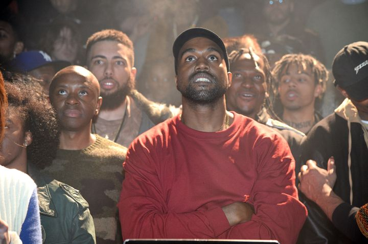 Yeezy and his crew looking outward towards the stage.