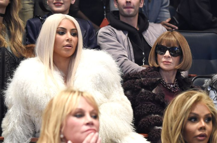 Kim Kardashian West and Anna Wintour watching the show.