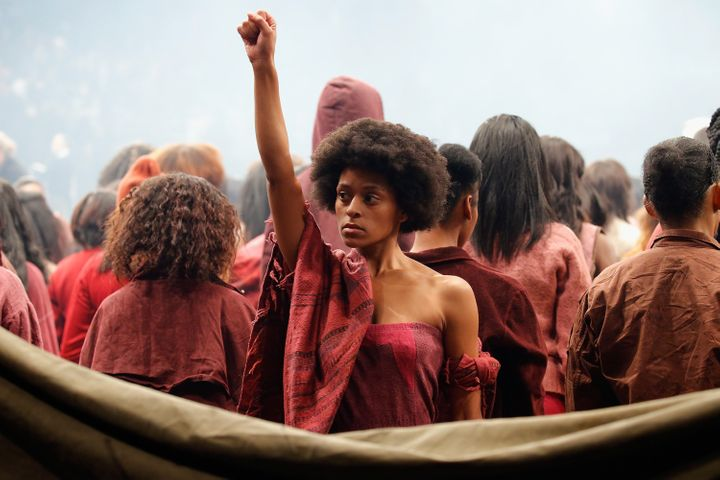 Model Elyssa Nicole raises black power fist.