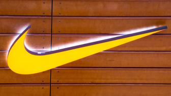 TORONTO, ONTARIO, CANADA - 2015/05/13: Brand Nike yellow sign or logo attached to a brown wooden wall.  Nike, Inc. is an American multinational corporation that is engaged in the design, development, manufacturing and worldwide marketing and sales of footwear, apparel, equipment, accessories and services. (Photo by Roberto Machado Noa/LightRocket via Getty Images)