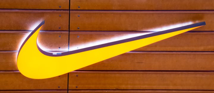 "The Nike ""swoosh"" is seen on a brown wooden wall in this 2015 file photo. The company won't manufacture custom shoes wit"