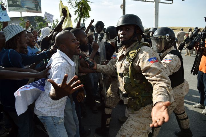 In the days leading up to Martelly's resignation, protestors in Port-au-Prince violently demandedhe step down.