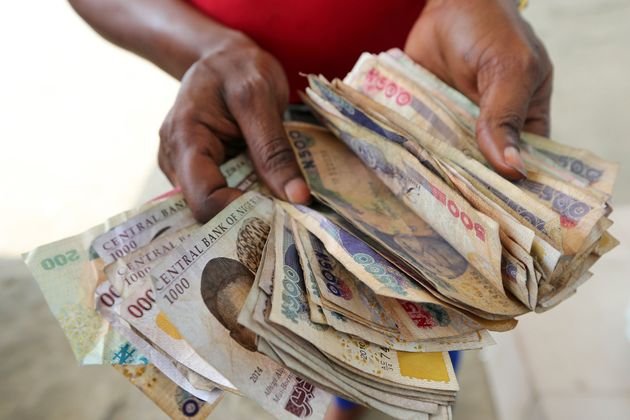 A large bundle of naira banknotes. The currency has plummeted in value on the black market amid the economic