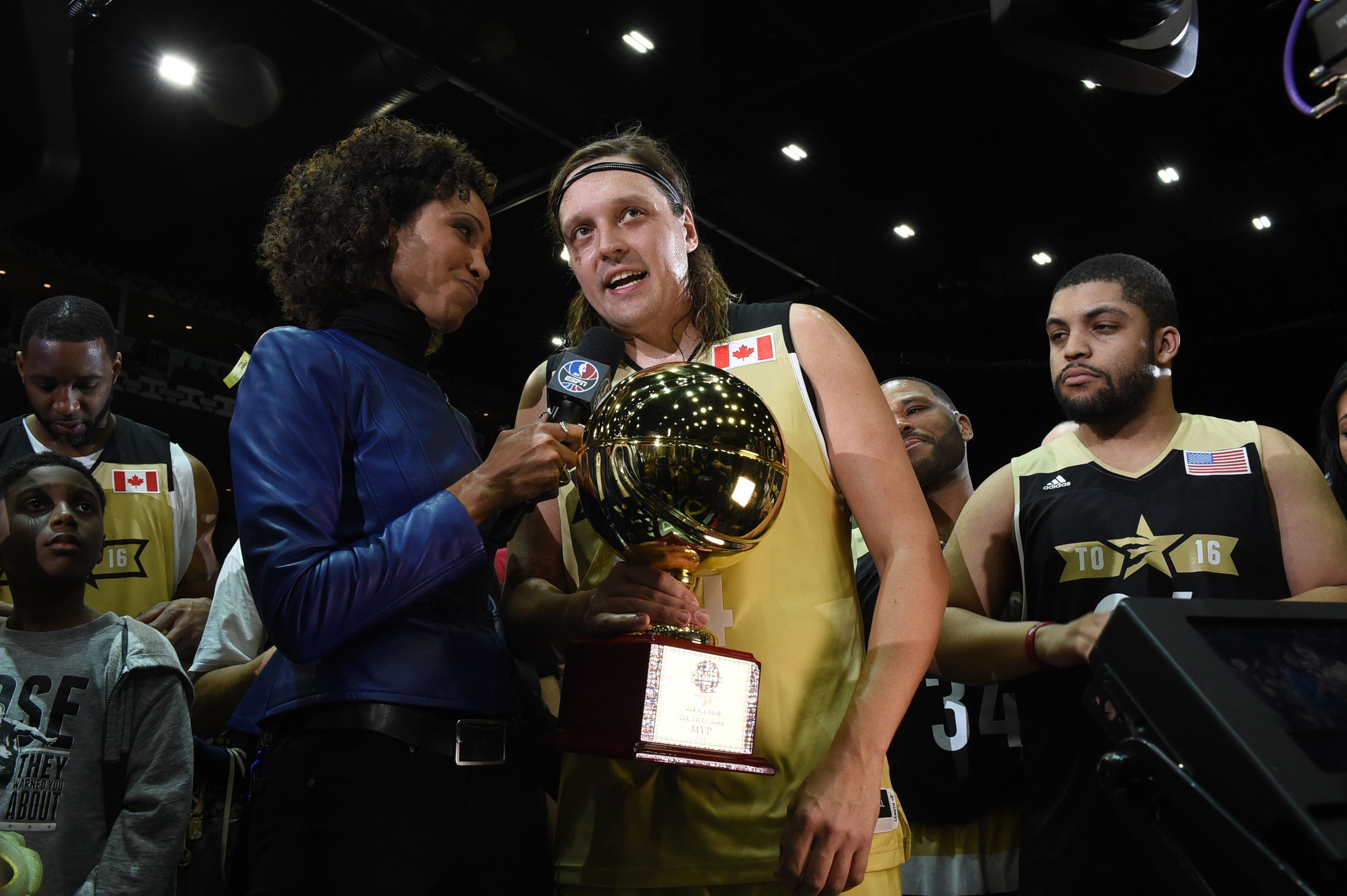 TORONTO, CANADA - FEBRUARY 12: Sage Steele of ESPN interviews Win Butler who won the MVP award during the NBA All-Star Celebrity Game Presented by Mountain Dew as part of 2016 All-Star Weekend at the Ricoh Coliseum on February 12, 2016 in Toronto, Ontario, Canada. NOTE TO USER: User expressly acknowledges and agrees that, by downloading and/or using this photograph, user is consenting to the terms and conditions of the Getty Images License Agreement.  Mandatory Copyright Notice: Copyright 2016 NBAE (Photo by Ron Turenne/NBAE via Getty Images)