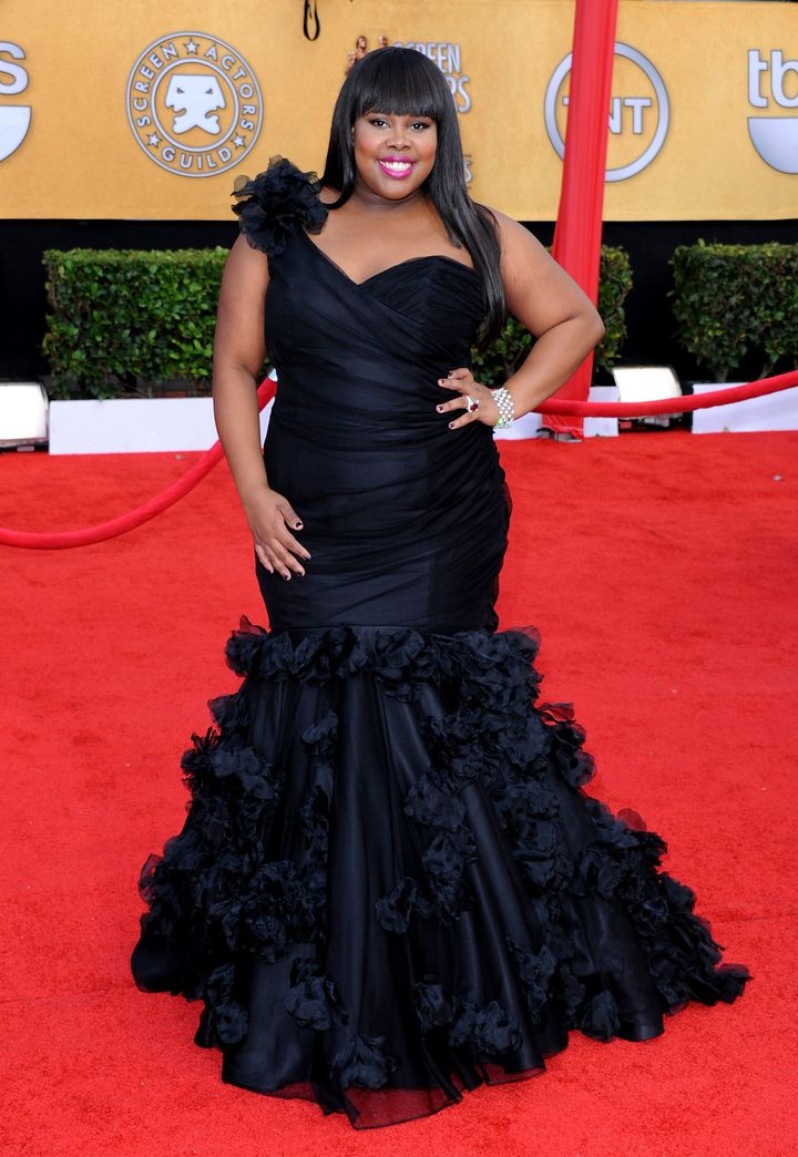 Amber Riley arrives at the 17th Annual Screen Actors Guild Awards.