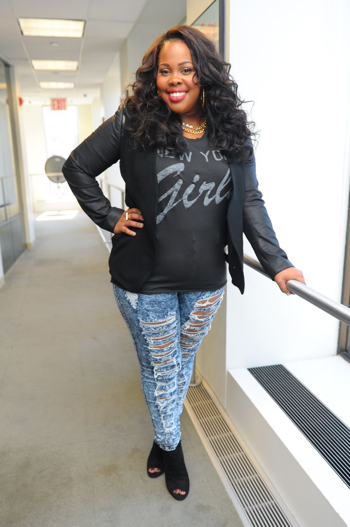 Amber Riley rocks a black blazer and ripped denim during a visit to the SiriusXM Studio in New York City.