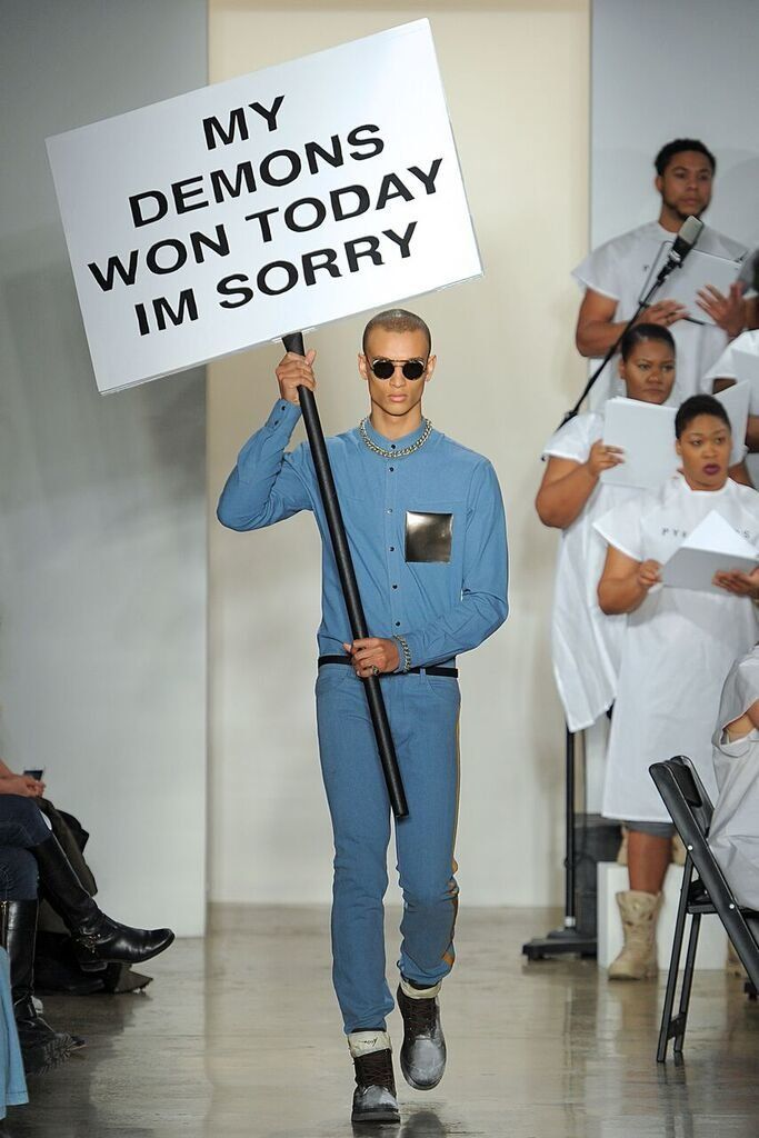 A model carries a sign with the last Facebook statusfrom activistMarShawn M. McCarrel II, who died last week.