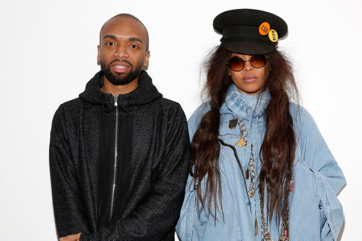 Fashion designer Kerby Jean-Raymond and stylist and singer-songwriter Erykah Badu pose backstage at the Pyer Moss Fall 2016 fashion show.
