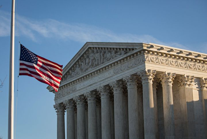 The flag at the Supreme Court flies at half-staff in honor of Justice Antonin Scalia.