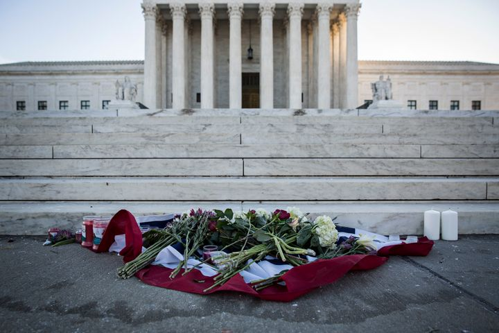 Flowers and candles sit at the bottom of the steps at the U.S. Supreme Court following the death of Justice Antonin Scalia.