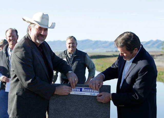 In this photo taken Wednesday March 19, 2014, Republican Rep. Doug LaMalfa, left, and Democratic Rep. John Garamendi, display