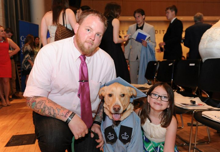 Brennan -- with his daughter, Madison, and his therapy dog, Mr. Luke -- are seen at Brennan's 2015 graduation from the Columb