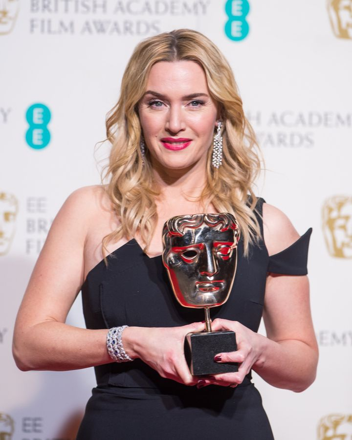 Kate Winslet poses in the winners room at the EE British Academy Film Awards at The Royal Opera House on February 14, 2016 in